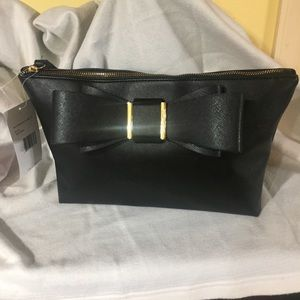 That's a Johnson cosmetic bag, NWT